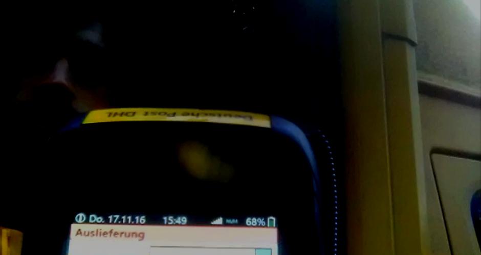 Beweisphoto eines DHL Scanners mit Datum und Fahrer
